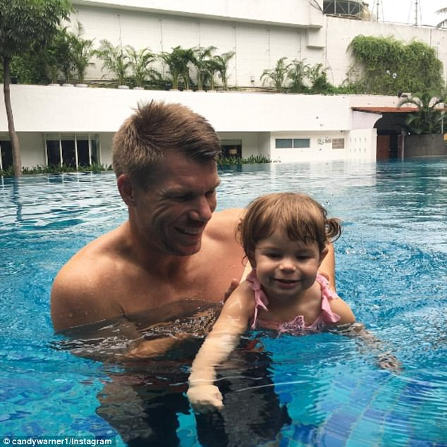 Making a splash: Candice sheared a second photo that showed dad David teaching youngest daughter Indi how to swim.