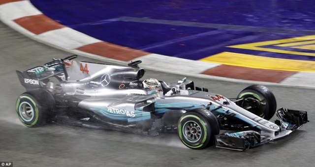 Lewis Hamilton took charge of the championship in Singapore as he surged to victory after Sebastian Vettel crashed out