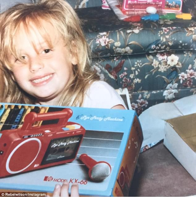 Sing star: Rebel Wilson has taken to Instagram to share a cute throwback photo that showed her receiving a gift of a karaoke machine