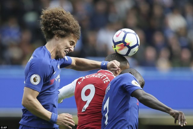 Chelsea defender Luiz  wears his effort on his face as he gets up above Lacazette and N'Golo Kante to win a header