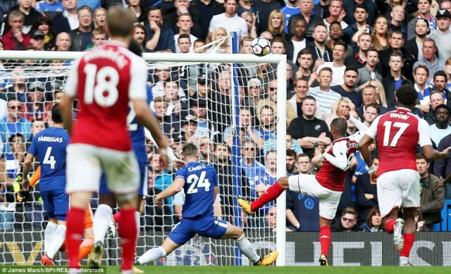 Lacazette wasted the best chance of the first half when he fired over after Aaron Ramsey's effort came back off the post