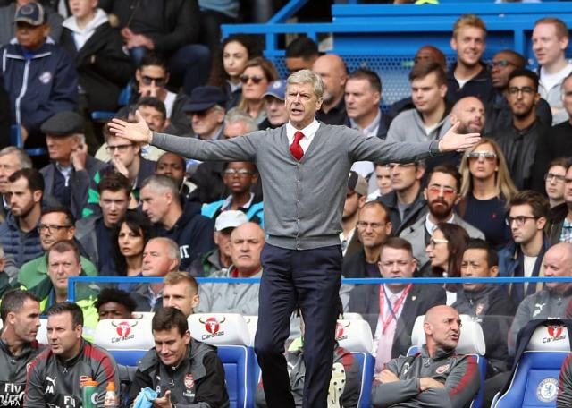 Arsene Wenger issues instructions from the touchline as his side look for a way to break the deadlock at the Bridge