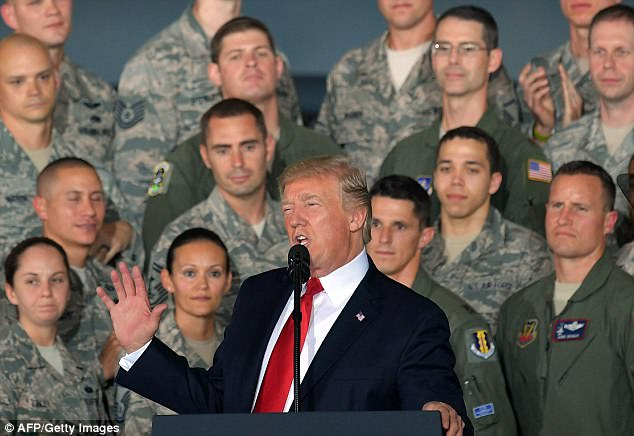 'I am more confident than ever that our options in addressing this threat are both effective and overwhelming,' Trump told airmen and women after personally reviewing their firepower at Joint Base Andrews in Maryland
