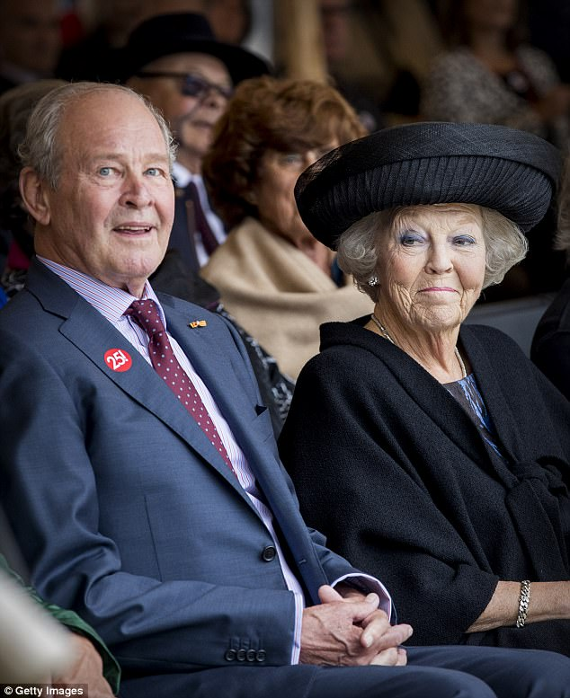 Princess Beatrix, who was also sporting a hint of blue eyeshadow, looked to be in excellent spirits as she met with museum officials including founder Jos de Pont (pictured)