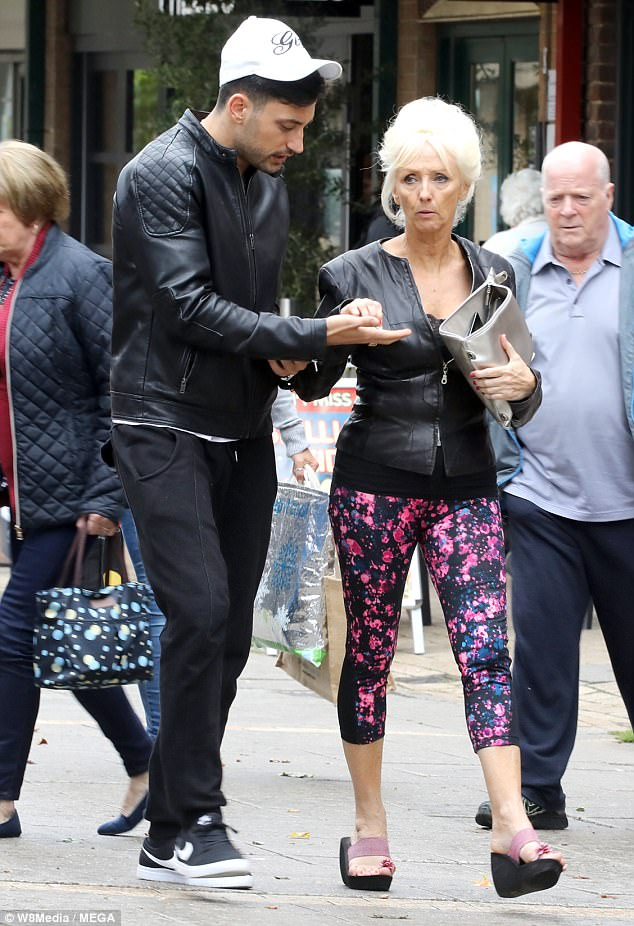 Elsewhere: In Reading, Debbie McGee and Giovanni Pernice were seen talking last-minute tactics taking a food break from a work out at the gym together