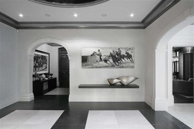 The property is decorated throughout in a sparse, black-and-white theme
