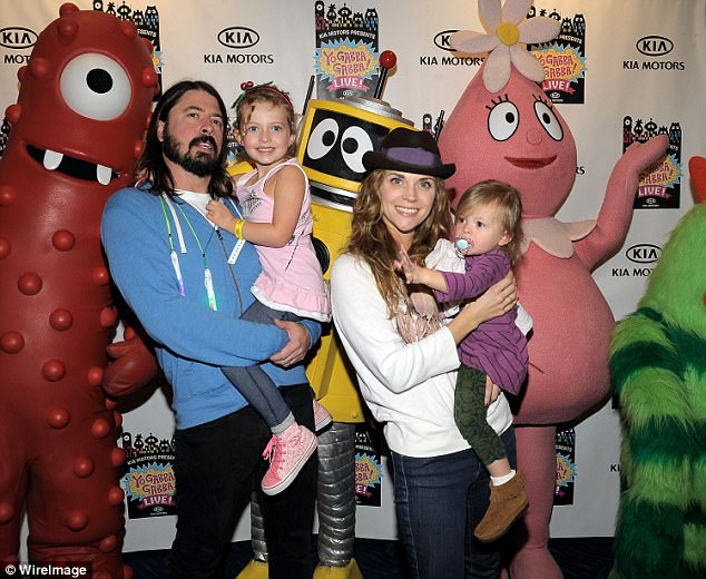 Happy family: Dave pictured with two of his three daughters back in 2010 with wife Jordyn