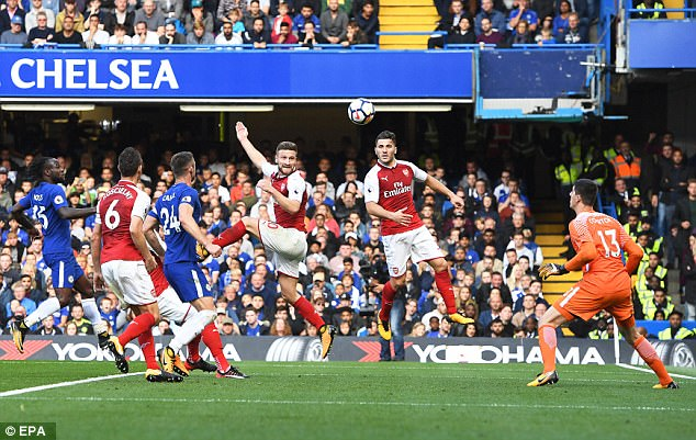 Arsenal's Shkodran Mustafi rises to loop a header towards goal but his effort was ruled out