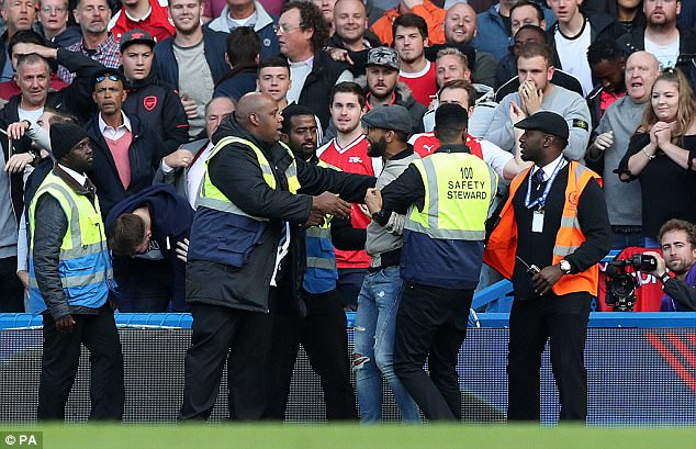 Stewards quickly made their way onto the pitch to escort the man out of the stadium