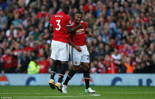 Eric Bailly celebrates with the United captain after Jose Mourinho's side made a blistering start to the contest at Old Trafford