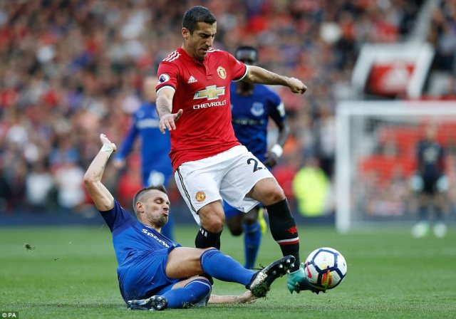 Morgan Schneiderlin slides in onHenrikh Mkhitaryan as the midfielder returned to face his former club at Old Trafford