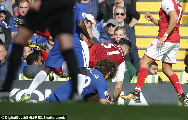 Conte believes Alexis Sanchez (right) fouled Luiz before he lunged in on the Gunners left back