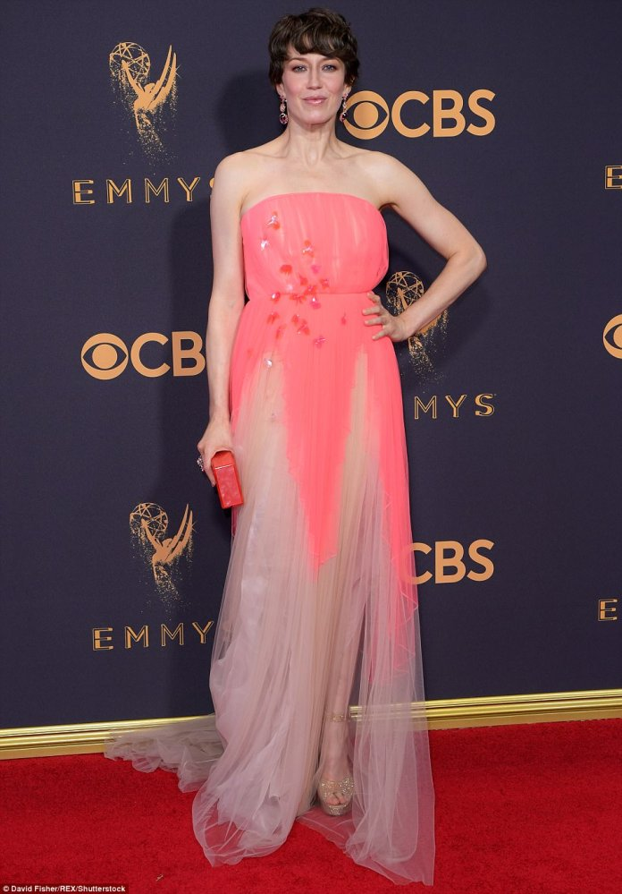 Neon brights: Carrie Coon, who stars in Fargo, wore a garish neon pink dress that featured plastic flower embellishments on the front