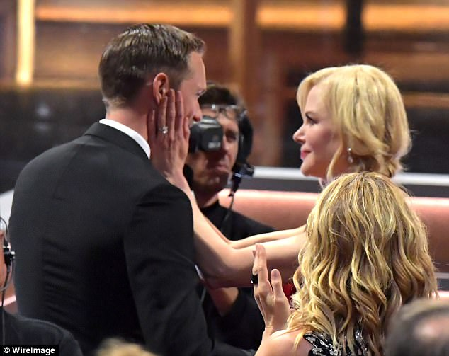 Getting touchy-feely: Nicole couldn't contain her excitement about Alexander's win and tenderly touched his face after he left the stage