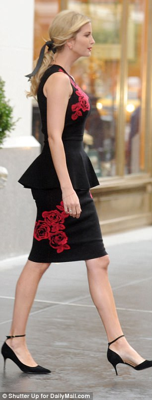 Figure-flaunting: For her outfit, she picked a red floral pattern dress