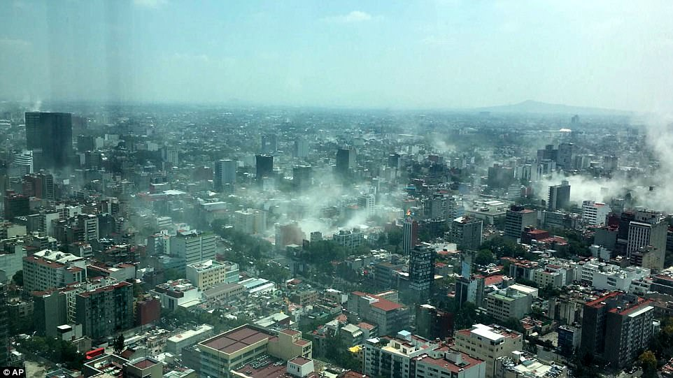 Dust rises over Mexico City on Tuesday after a 7.1-magnitude earthquake struck Raboso, a town south of the capital. The photo was taken through a window in the iconic Torre Latinoamericana tower in downtown Mexico City