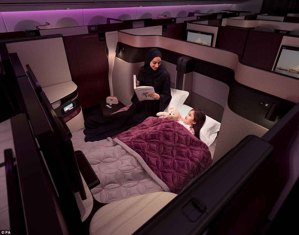Sleep on it: Customers in adjoining seats can create their own double bed by removing privacy panels on a daily Boeing 777 service from London Heathrow