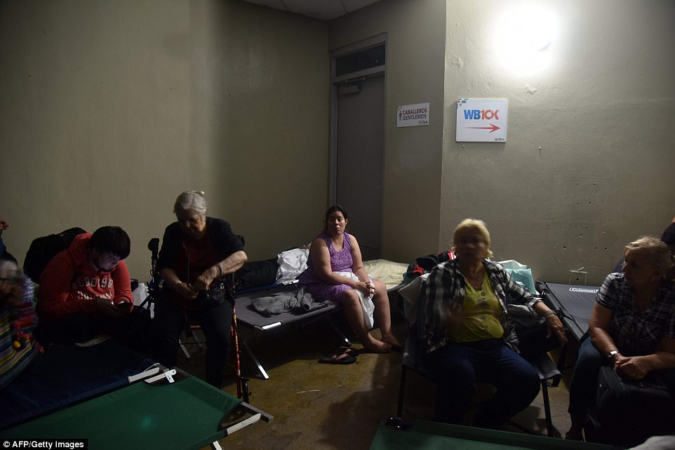 People take shelter at Roberto Clemente Coliseum in San Juan, Puerto Rico, on September 20, 2017