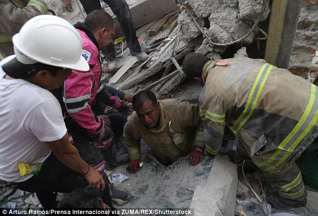 A person is rescued from the debris in Mexico City after the devastating earthquake