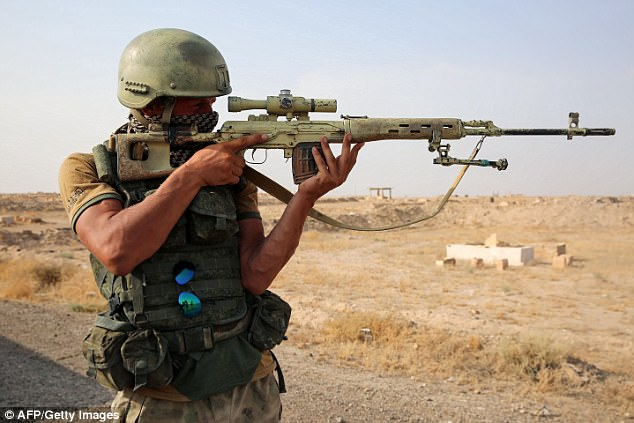 Russian commanders in Syria have warned they will fire on positions occupied by the Syrian Democratic Forces, who are being supported by the US, if they are threatened (pictured, a Russia sniper in Syria)