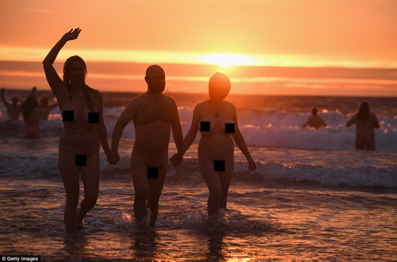 Dozens of naked people take a swim in the North Sea to raise money for charity (photos)
