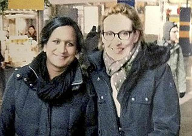 Family first: German tabloid Bild used this picture of Dr Alice Weidel with her partner Sarah Bossard, with whom she has two children