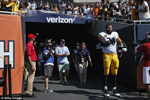 Speaking his truth: Alejandro Villanueva spoke out for the first time since taking the field alone on Sunday for the national anthem (above) while his teammates remained in the tunnel