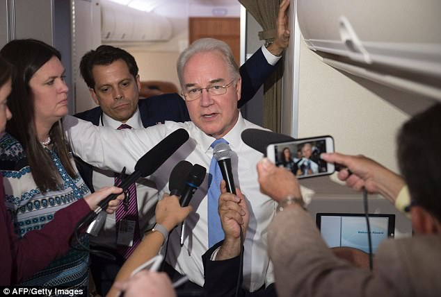 Secretary of Health and Human Services Tom Price speaks with reporters aboard Air Force One in flight during a trip with US President Donald Trump to Beaver, West Virginia, July 24, 2017.