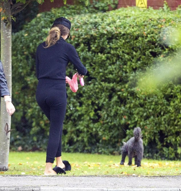 Picking it up:The 25-year-old TOWIE star was walking her beloved dog Daisy, who managed to tarnish Megan's glam image after relieving herself on the street
