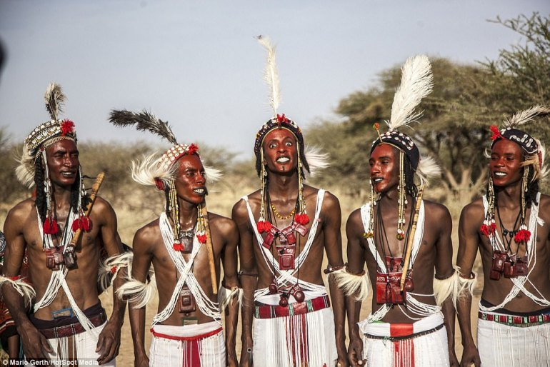 The photographer said that the fact that the women watching may already have a husband is not important since the Wodaabe people are a polygamous tribe