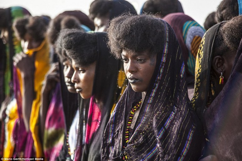 Colourfully dressed female members of the tribe line up as they take part in the traditional courtship festival in northern Niger
