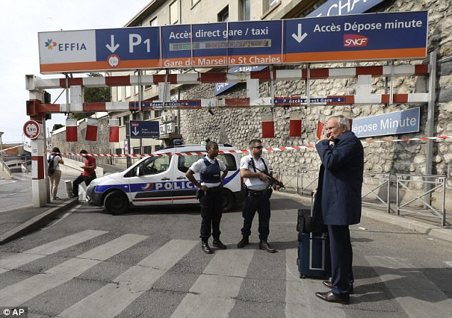 French security services are pictured guarding the Gare de Marseille-Saint-Charles after today's deadly attack, which left two women dead, including one with a 'slit neck'