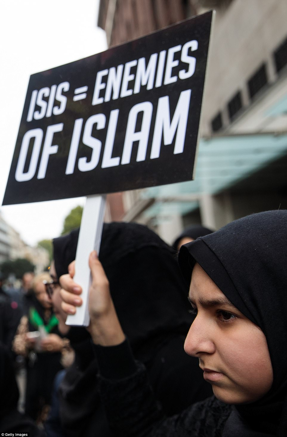 Protesters waved placards condemning acts of terrorism carried out by Islamic State as Muslims marked Ashura in London