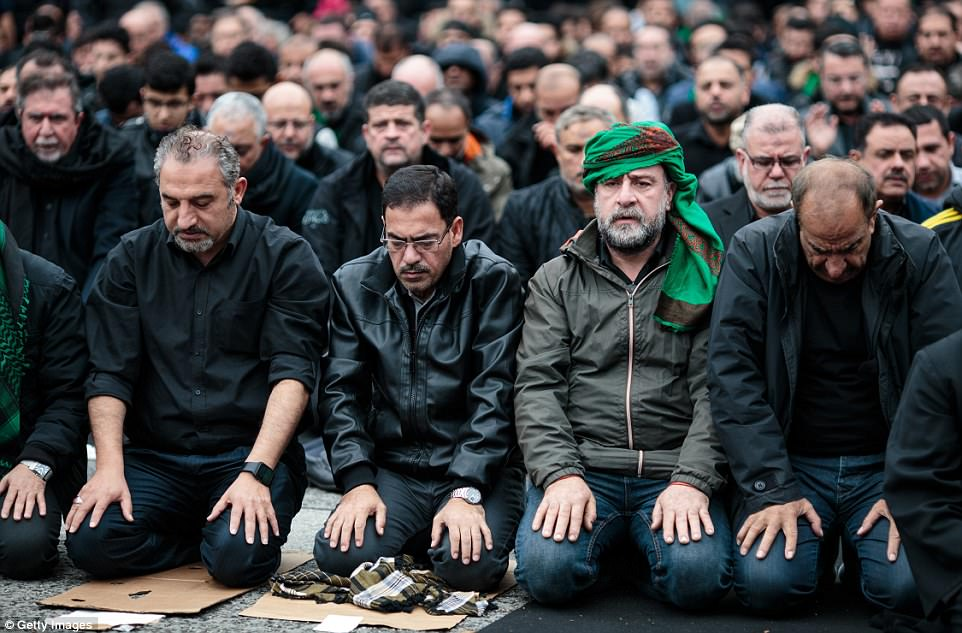 Muslims kneel to pray in central London, where the Ashura commemorations were used to remember the victims of extremism