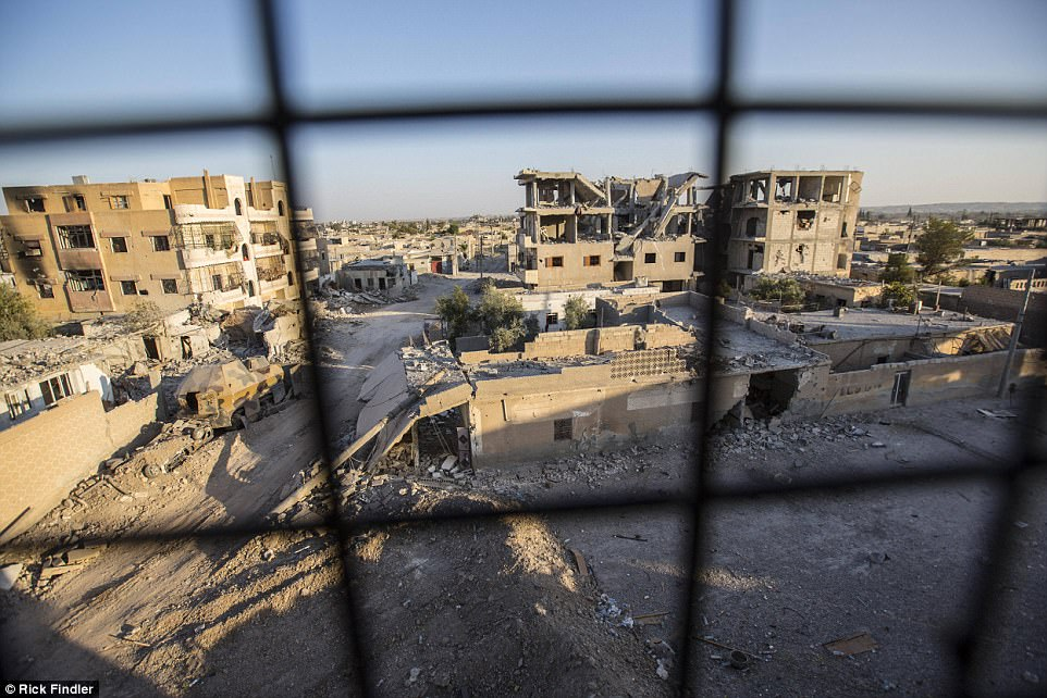 A general view of the Al-Nahda neighbourhood of western Raqqa.While being interviewed for this story, he spoke of a group of MFS fighters he wanted to get moving.He said: 'That's the problem with these guys. They hang around for so long and make so much noise that the ISIS drones just come along and drop a bomb on their heads'