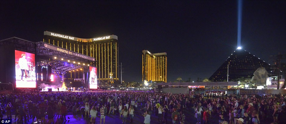 Police run to cover at the scene of a shooting near the Mandalay Bay shooting