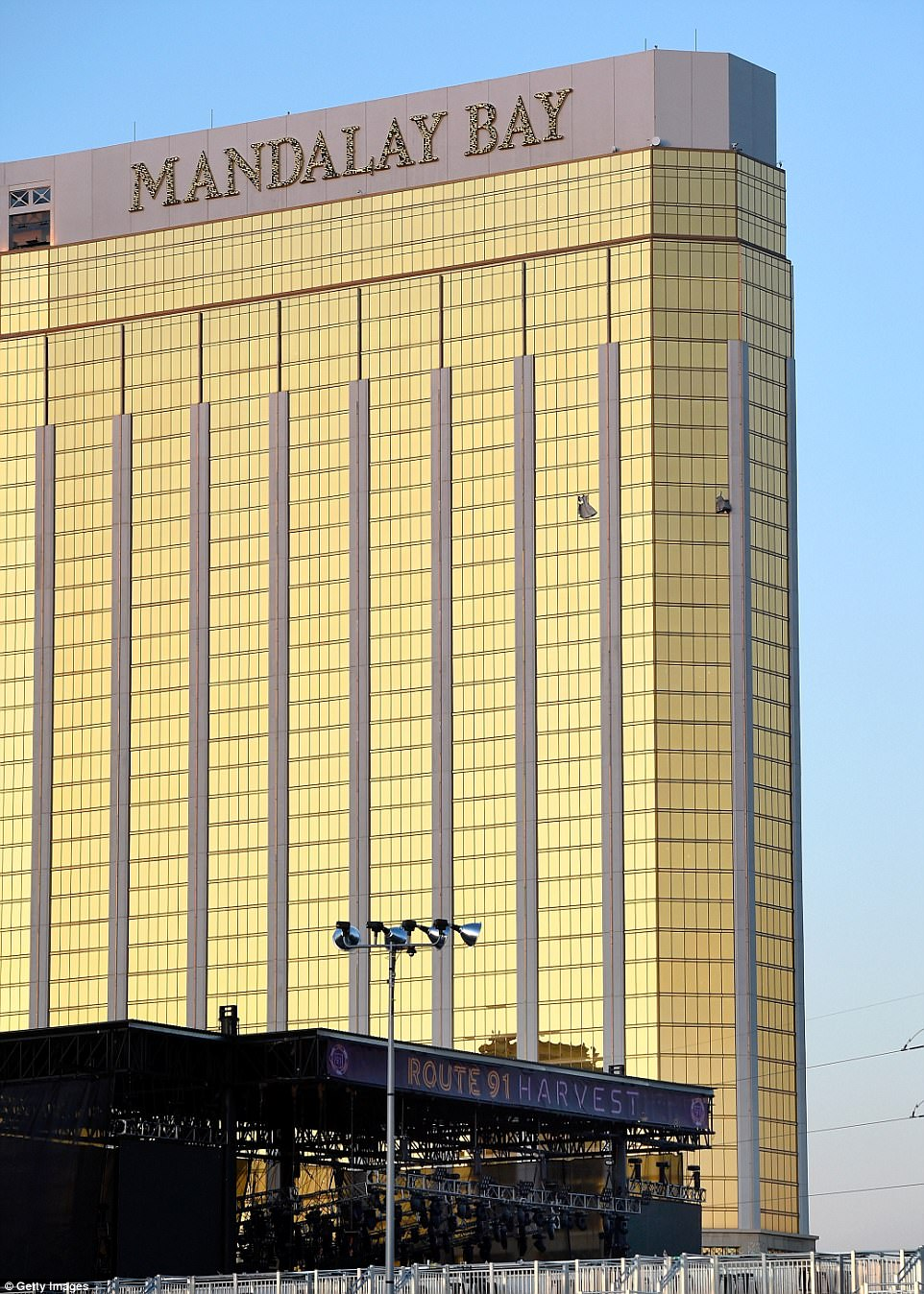 A Monday morning photo shows two windows blown out on the 32nd floor. Police believe Paddock was firing out of both