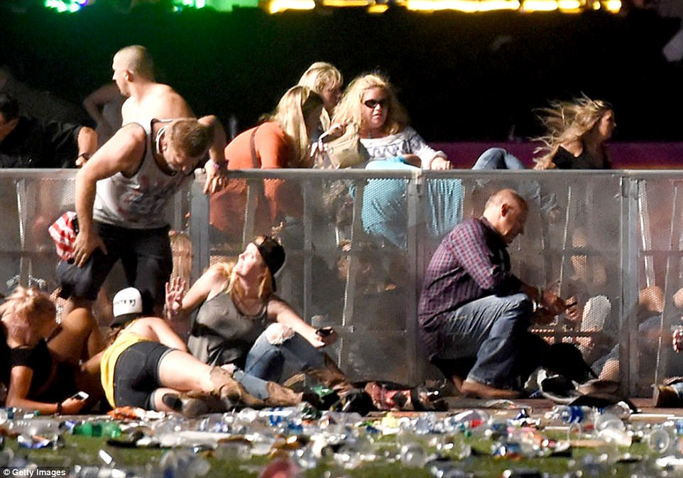 People dive for cover at Route 91 Harvest country music festival after apparent gun fire was heard on October 1, 2017 in Las Vegas, Nevada