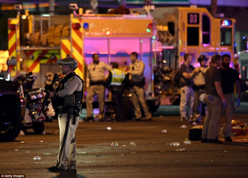 A Las Vegas Metropolitan Police Department officer stands in the intersection of Las Vegas Boulevard and Tropicana Ave. after a mass shooting at a country music festival nearby on October 2, 2017 in Las Vegas, Nevada