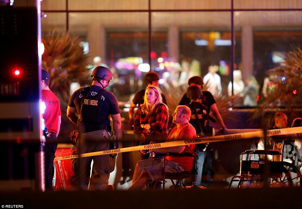 People wait in a medical staging area on October 2, 2017, after a mass shooting during a music festival in Las Vegas, Nevada, U.S.
