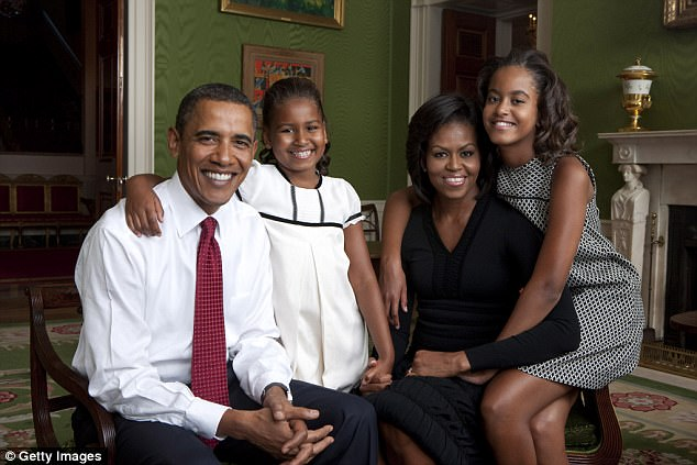 The Obamas. The family sits for portrait in the Green Room of the White House September 1, 2009 in Washington, DC