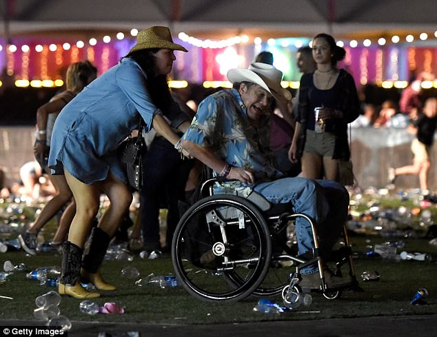 'A man in a wheelchair was helped to an exit': Becker recalled what he saw as the 22,000 concert-goers fled as gunfire rang out