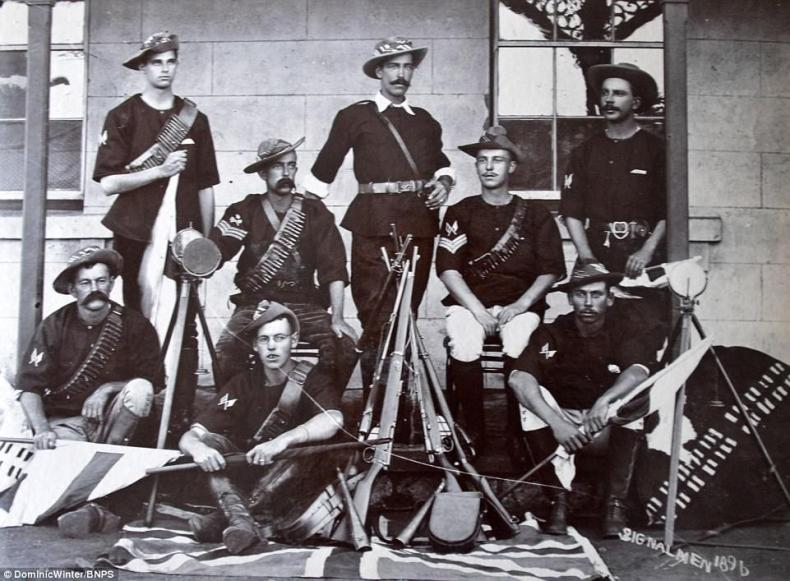 These signalmen can be seen posing for a photograph along with their flag equipment, guns and ammunition in 1896