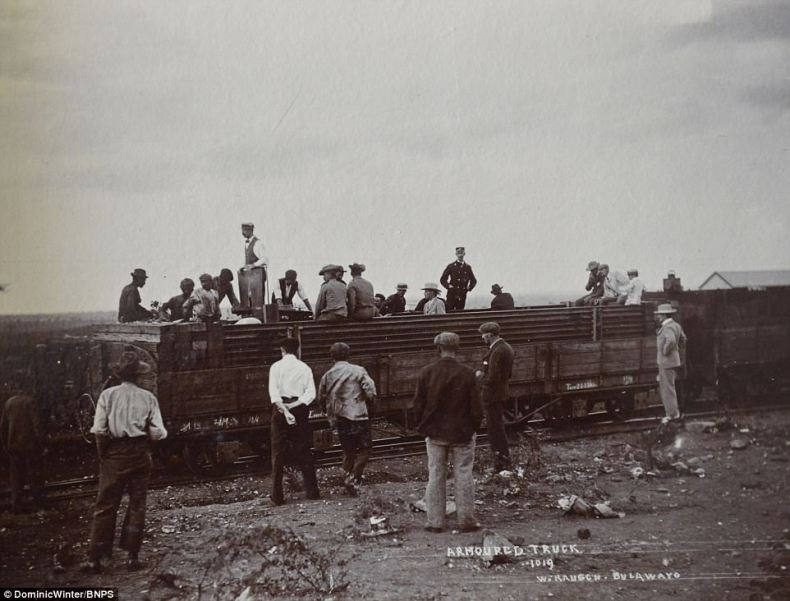 An armoured train carriage can be seen in this photo taken by photographer W. Rausch along with military men attending to the machine