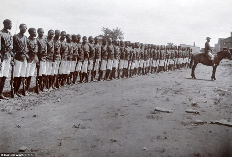 The photos, taken by W. Rausch who ran a studio in the town of Bulawayo, were captured during the 'Scramble for Africa' when European nations were vying for control of the continent and its resources. Pictured, native soldiers lined up with their guns