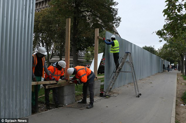 Petrol cans and a 'crude' detonator have been discovered under a truck in Paris, it has emerged. It comes as workmen continue work to build bullet-proof glass walls around the Eiffel Tower amid a heightened terror threat in France