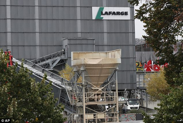A device was found this morning under a lorry belonging to Franco-Swiss cement company Lafarge in the northeastern part of the French capital(pictured today)