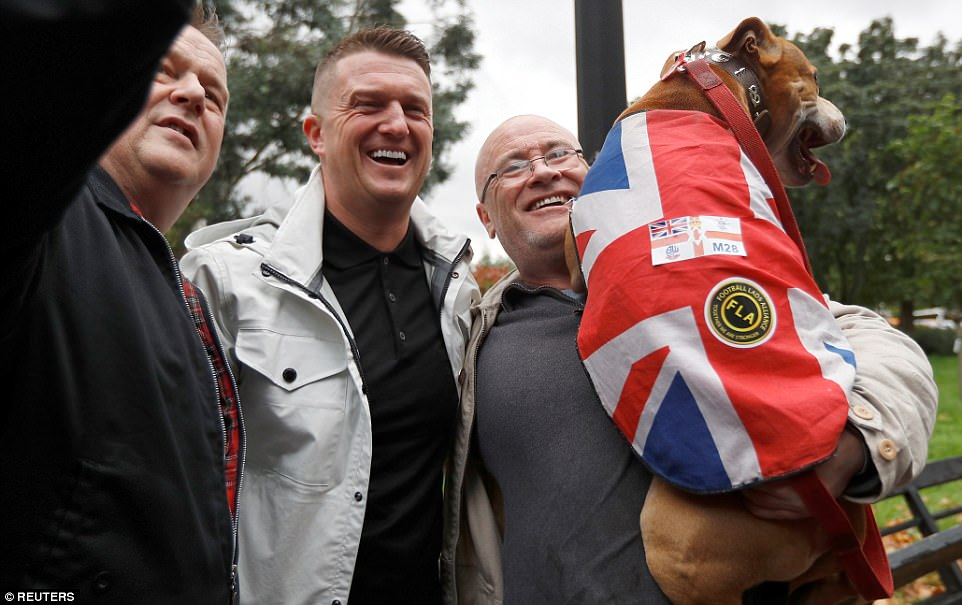 Tommy Robinson, founder of the English Defence League, was spotted smiling with members of the Football Lads Alliance