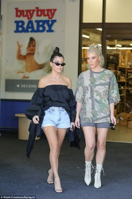 That's the spot:Stopping by a branch of Best Buy Baby, Kim and sister Kourtney cooed over baby items together
