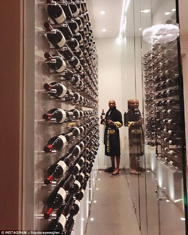 Floyd Mayweather has flaunted his 'fine wine' collection in his Beverly Hills mansion
